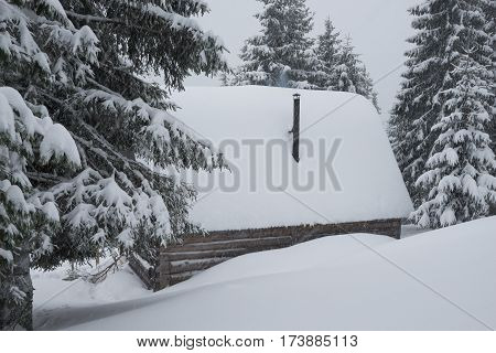 Old Shelter In The Winter Mountains During A Long Snowstorm