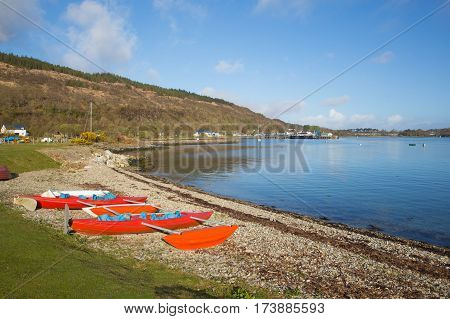 Craignure Isle of Mull Argyll and Bute Scotland uk near to ferry port with boats and blue sky in spring