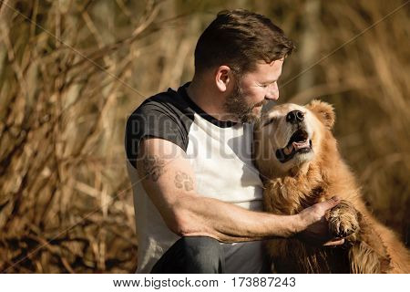 Man with golden retriever