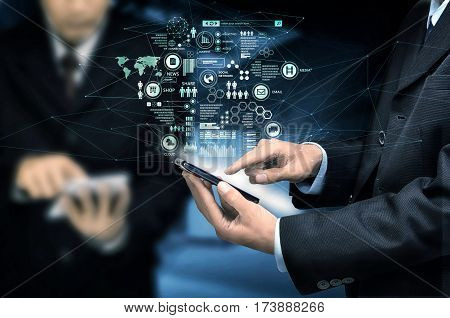 Businessman use his smart phone to work or acces the internet.