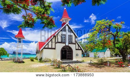 landmarks of  Mauritius island - beautiful Red church on the beach