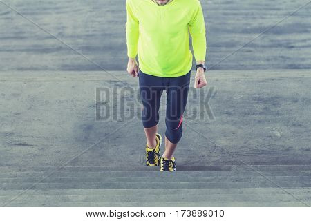 Urban jogger with sports outfit on the staircase.