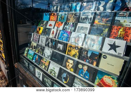 LJUBLJANA SLOVENIA - FEBRUARY 19 2017: Shadow of unrecognizable person standing in front of the music games and movies CD and DVD shop window in Ljubljana capital of Slovenia