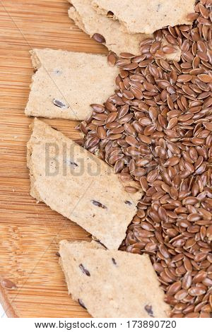 Flax Seeds With Flax Snacks On The Wooden Board