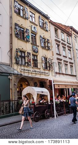 Lviv Ukraine - July 25 2016: Facade of famous handmade confectionery Lviv Chocolate Workshop building. Its owner is !FEST company network of concept restaurants and cafes founded in Lviv in 2007.