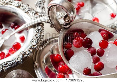 Beautiful Ice Cubes And Red Berries Closeup.