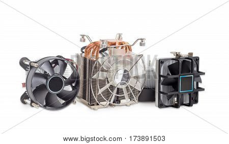 One active CPU cooler with a large finned heatsink fan copper thermal pad with heat pipes and several various CPU coolers with aluminum finned heatsinks and fans on a light background