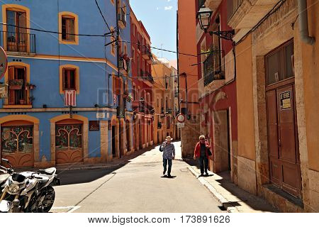 TARRAGONA/ SPAIN - MAY 16, 2015. An elderly couple on the street Carrer de Santes Creus in the historical town of the city Tarragona. Catalonia, Spain.