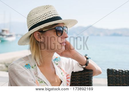 beautiful 20-29 years old woman in a hat. Summer, vacation, holiday, active people lying on beach