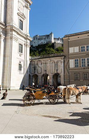 SALZBURG AUSTRIA - APRIL 29 2016: Fiaker at Cathedral Square in Salzburg Austria