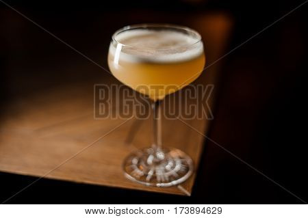 the glass with coctail on the table