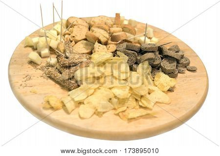 assorted chips and crackers on a wooden tray isolated white background