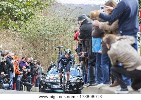 Conflans-Sainte-HonorineFrance-March 62016: The American cyclist Ian Boswell of Team Sky riding during the prologue stage of Paris-Nice 2016.