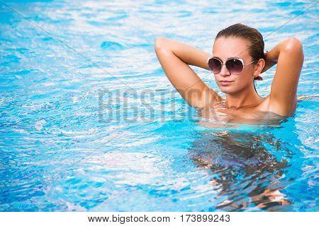 Beautiful Tanned Sexy Girl In Bikini Posing In Swimming Pool