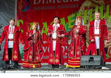 GOMEL BELARUS - MARCH 12 2016: Speech by creative choral collective. Concert was conducted in open air with open free access for all comers during mass Shrovetide celebrations