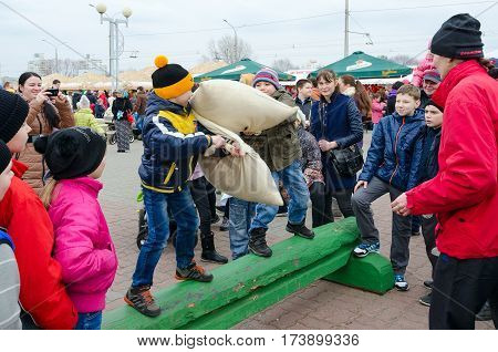 GOMEL BELARUS - FEBRUARY 21 2016: Shrovetide entertainment. Unidentified children participate in comic battles on pillows