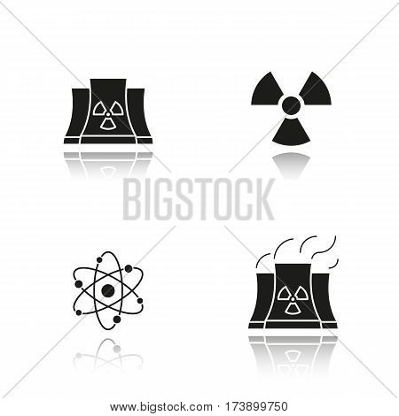 Atomic energy drop shadow black icons set. Nuclear power plant with smoke, radiation and atom symbols. Isolated vector illustrations