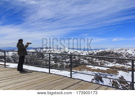 SHANGRI-LA CHINA - APRIL 15 2015 : Tourist is taking picture at Blue Moon Valley also called Shika Snow Mountain located in Shangri-La (Zhongdian) of Yunnan China.