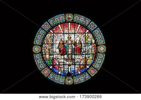 CATALONIA, SPAIN-JUNE 06, 2015: Stained glass Jesus crowning Mary God the father in rose window basilica inside Monastery of Montserrat, Barcelona, Catalonia, Spain