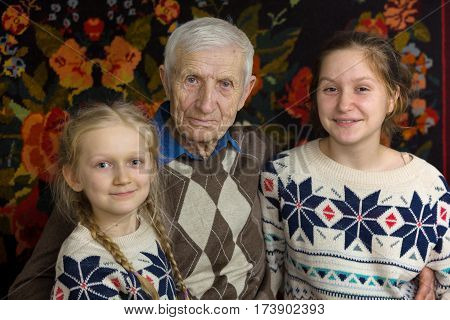 portrait of smiling senior man and the great-granddaughters