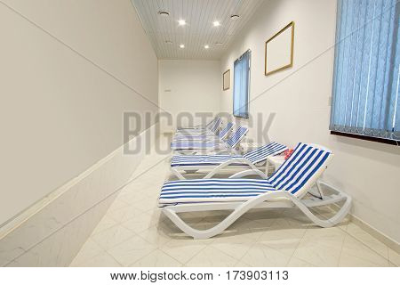 Chaise-longues in a fitness-hall, spa or so on