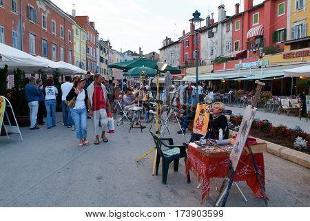 People Walking At The Market Of Rovinj On Croatia