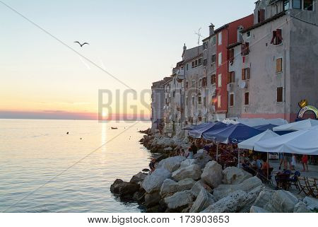 Rovinj Croatia - 24 August 2004: People dining at restaurants at the picturesque town of Rovinj on Croatia