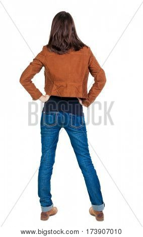 back view of standing young beautiful  brunette woman in brown jacket. girl  watching. Rear view people collection.  backside view of person.  Isolated over white background.