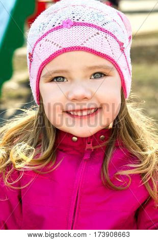Portrait of happy cute little girl on a spring day outdoors