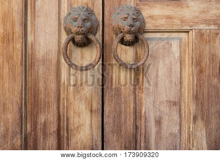 Back ground of antique, classical wooden door and knocker