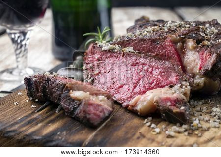 Barbecue dry aged Wagyu Steak as close-up on a cutting board