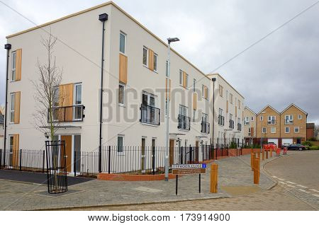 Bracknell, England - February 26, 2017: New build apartment block on a modern housing estate in Bracknell, England on a cloudy day
