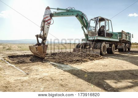 Excavator and truck on a construction site