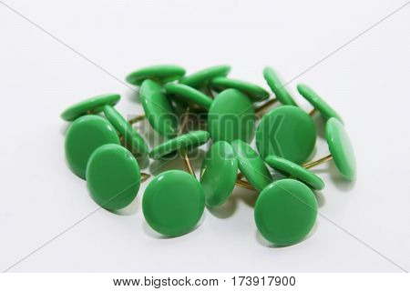 bunch of round green push pins on a white background