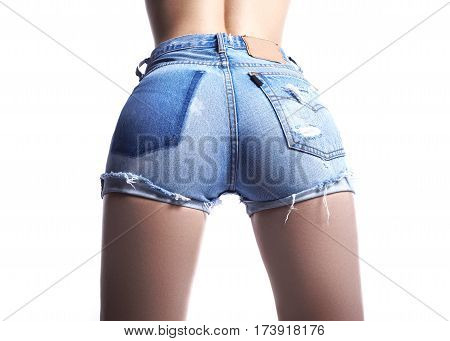 Sexy woman in fashion blue jeans shorts. Perfect hot booty and erotic curves hips. Good body shapes whithout cellulite. Sport and diet.