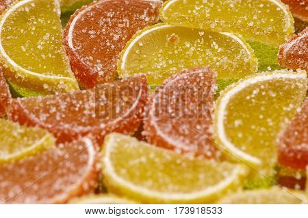 Colorful sugary marmalade like lemon and orange slices covered with sugar. Fruit jelly candies. Dolce vita. Closeup
