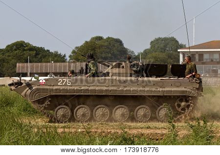 WESTERNHANGER, UK - JULY 17: A Russian cold war period OT90 fighting vehicle does a series of stunts in the main arena for the watching public at the War & Peace show on July 17, 2013 in Westernhanger