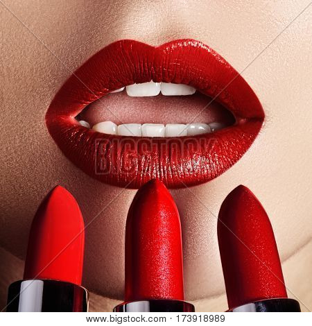 Close-up Of Woman's Lips With Fashion Red Make-up. Macro Shot Of Beautiful Make Up On Full Lips. Cho