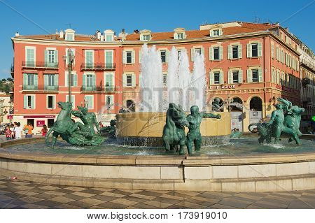 NICE, FRANCE - JULY 21, 2009: View to the Fontaine du Soleil at the Place Massena square on a hot day in Nice, France. Place Massena is the main public square in Nice.