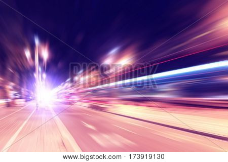 Abstract image of traffic lights in motion blur in the city.