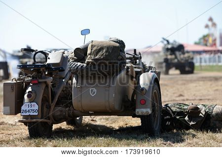 WESTERNHANGER, UK - JULY 19: A German WW2 motorcycle and sidecar combo is left abandoned in the middle of the re-enactors battlefield at the War & Peace show on July 19, 2013 in Westernhanger