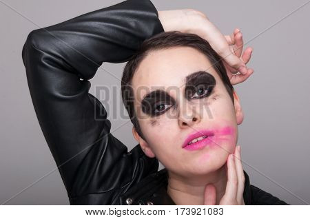 Fashion Portrait Of Young Female With Excentric Makeup