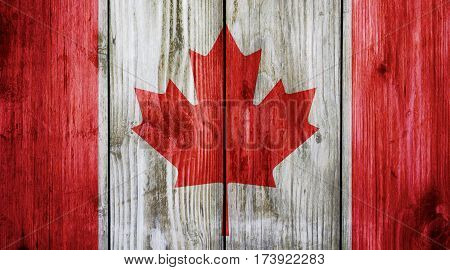Canada flag on wood texture background. Abstract Flag background.