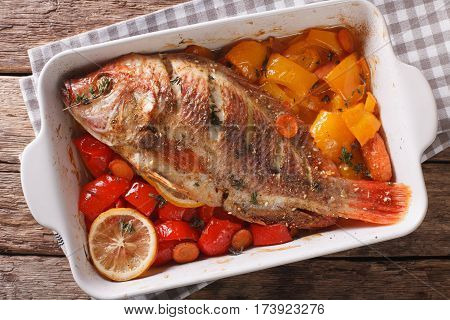 Tilapia Baked With Vegetables And Thyme Close Up In Baking Dish. Horizontal Top View