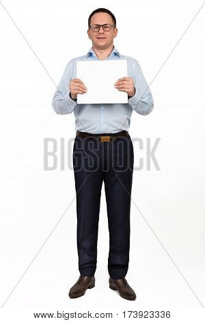Full Length Portrait Of Happy Smiling Young Businessman In Glasses Showing Blank Signboard, With Cop