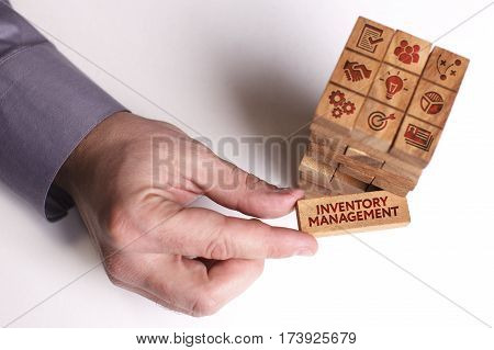 Business, Technology, Internet And Network Concept. Young Businessman Shows The Word: Inventory Mana