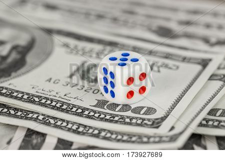 white dice on a hundred dollar bill closeup