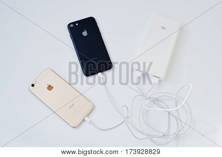 Hai, Ukraine - March 1, 2017:  Xiaomi Power Bank 20000 Mah With Apple Iphone 7 And 6S Isolated On Wh