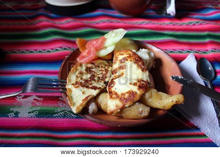 Peruvian breakfast with cheese, typical food in Titicaca Lake, in the Andes