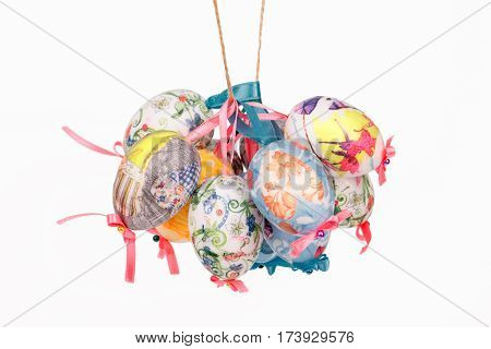 Colorful Easter decoupage eggs isolated on white background